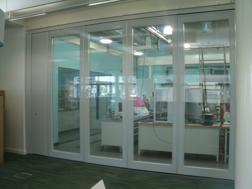 Closed Glass Wall Partitions seperating hallway and technician room