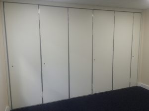 Closed Sliding Walls, separating two small rooms