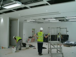 Working on Installation of Wall Partitions