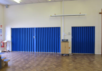 Blue Concertina Walls Closed In School