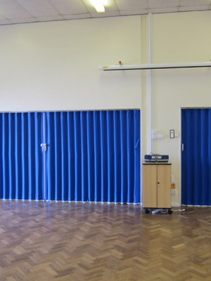 Blue Concertina Walls Closed In School