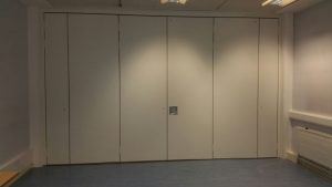 high acoustic sliding wall separating two rooms