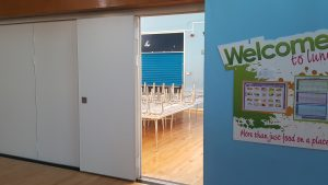 School dining room sliding partition door open