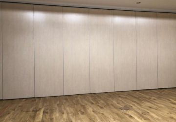 Movable wall for storage in Gym